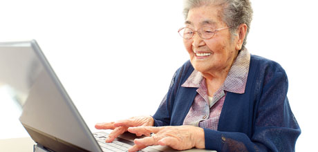 Resources - older woman working on laptop